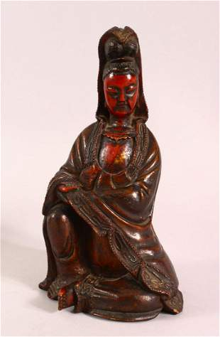 A CHINESE LACQUERED WOOD FIGURE OF GUANYIN, in a seated