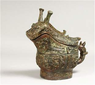 AN ARCHAIC BRONZE SMALL CENSER AND COVER.