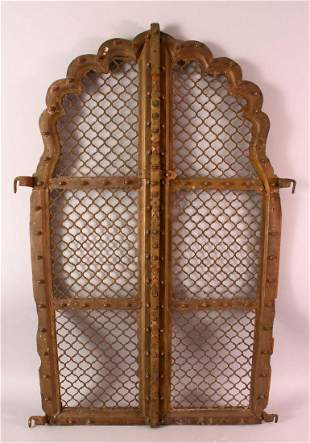 A PAIR OF INDIAN CARVED ROSEWOOD ARCHED WINDOW