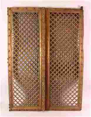 A PAIR OF INDIAN CARVED ROSEWOOD WINDOW SHUTTERS, with