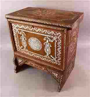 A MOTHER OF PEARL INLAID WOOD SMALL CUPBOARD, with a