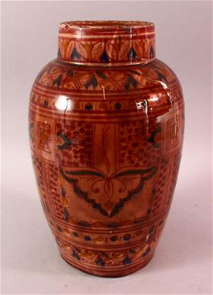 A LARGER NORTH AFRICAN RED GLAZED POTTERY VASE, with