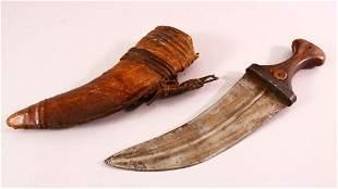 AN ARAB JAMBIYA DAGGER, with horn handle and hide