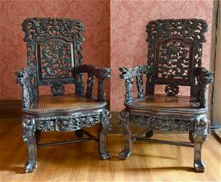 A GOOD PAIR OF CHINESE CARVED AND PIERCED ARMCHAIRS