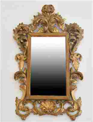 A SMALL ITALIAN FLORENTINE GILTWOOD MIRROR with