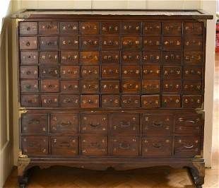 A CHINESE NARROW CABINET with SIXTY-TWO DRAWERS. 3ft