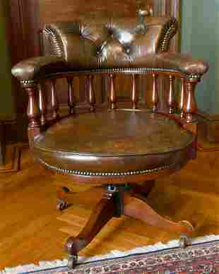 A GOOD MAHOGANY AND LEATHER TUB SWIVEL OFFICE CHAIR