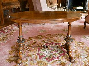 A VICTORIAN OVAL WALNUT STRETCHER TABLE with turned