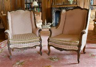 A GOOD PAIR OF MAHOGANY WING ARMCHAIRS with show wood