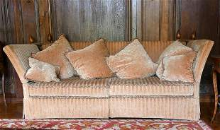 A LARGE PAIR OF KNOLL SETTEES. 7ft long.