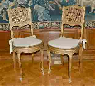 TWO GILT CANE SEATED CHAIRS.