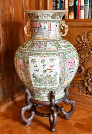 A LARGE CHINESE CANTON TWO-HANDLED BULBOUS VASE, on a