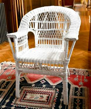 A WHITE PAINTED CANE CHAIR.