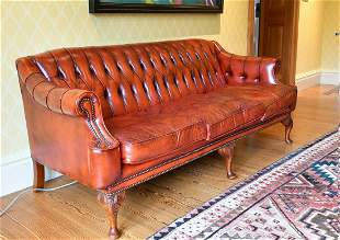 A SUPERB BUTTONED BACK LEATHER SOFA with scroll ends,