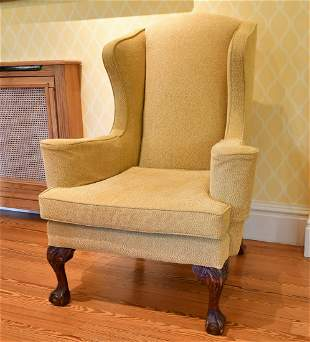 A GEORGE III STYLE MAHOGANY WING BACK ARMCHAIR, on