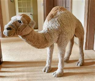 A LARGE WOOLLY CAMEL. 5ft long x 3ft 6ins high.