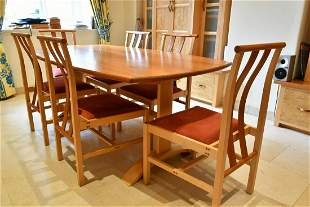 A MODERN DINING TABLE AND SIX CHAIRS, made of brown oak