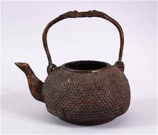 AN EARLY CHINESE BRONZE CIRCULAR KETTLE, with swing