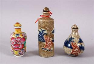 THREE CHINESE PORCELAIN SNUFF BOTTLES, one of floral