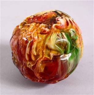 A CHINESE CARVED BAKELITE OR CHERRY AMBER ZODIAC BALL,