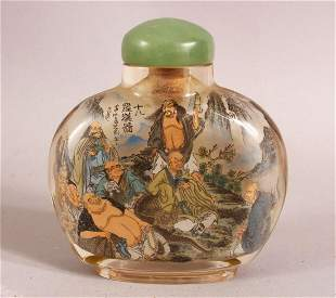 A CHINESE REVERSE PAINTED SNUFF BOTTLE - painted with