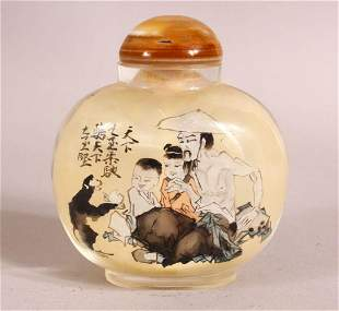 A CHINESE REVERSE PAINTED SNUFF BOTTLE - decorated with