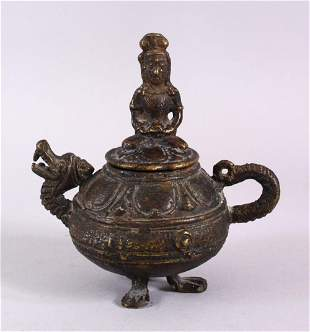 AN EARLY CHINESE OR SOUTH EAST ASIAN BRONZE LIDDED OIL