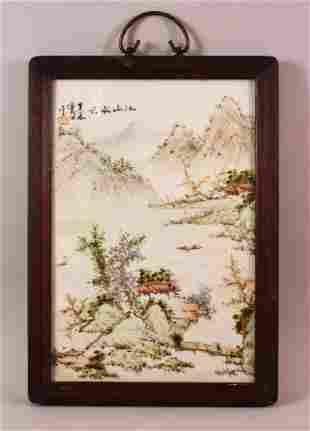 A CHINESE FAMILLE ROSE PORCELAIN FRAMED PANEL -
