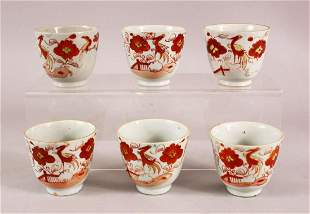 A SET OF SIX ARITA PORCELAIN CUPS, each painted with