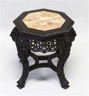 A CHINESE CARVED HARDWOOD AND MARBLE INSET OCTAGONAL