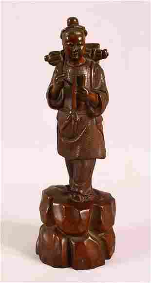 A 19TH CENTURY CHINESE CARVED WOODEN FIGURE OF A