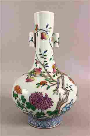 A CHINESE DOUCAI DECORATED PORCELAIN FRUIT VASE - with