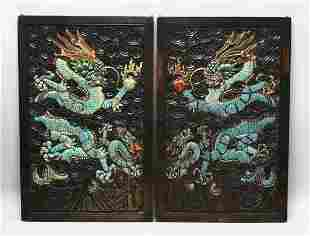A PAIR OF CHINESE CARVED AND PAINTED HARDWOOD PANELS,
