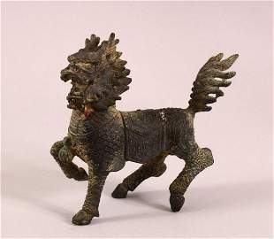 A CHINESE BRONZE STANDING FIGURE OF KYLIN, 13cm long.