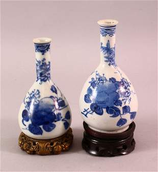 TWO CHINESE BLUE & WHITE PORCELAIN VASES & STANDS, each