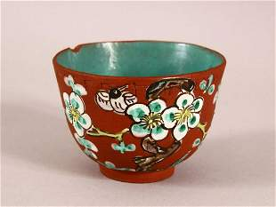 A CHINESE YIXING CLAY TEA BOWL - the exterior enameled