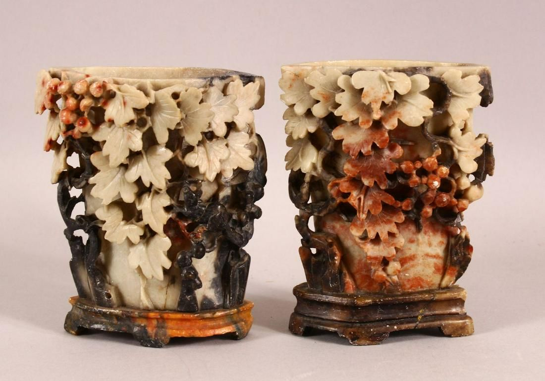 A PAIR OF CHINESE CARVED SOAPSTONE VASES - each carved
