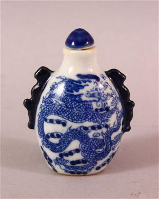 A CHINESE BLUE AND WHITE TWIN HANDLED PORCELAIN SNUFF