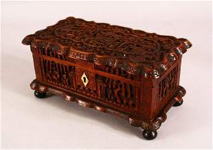 A 19TH CENTURY CHINESE CARVED WOODEN CANTON LIDDED BOX