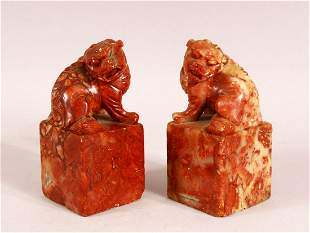 A PAIR OF CHINESE CARVED SOAPSTONE LION DOG SEALS - The