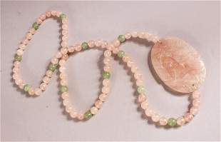 A CHINESE ROSE QUARTZ CARVED NECKLACE / PENDANT - with