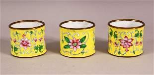 THREE CHINESE YELLOW ENAMEL NAPKIN RING HOLDERS,