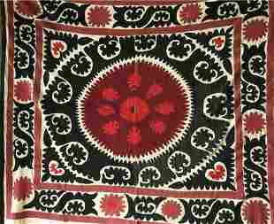 A HAND EMBROIDERED BLACK AND RED WALL COVERING /