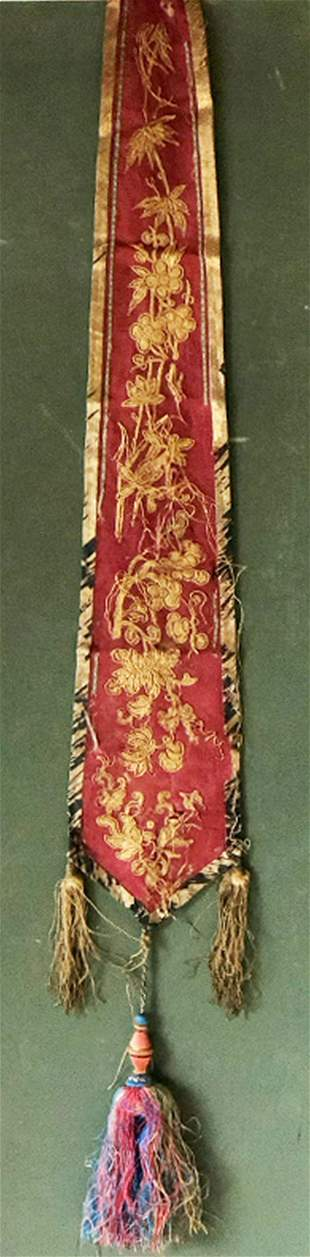 A CHINESE APRON SKIRT PANEL, Circa 1920, red silk with