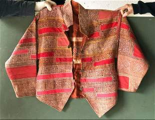 AN EMBROIDERED ETHNIC JACKET, 20th Century, silk lined,