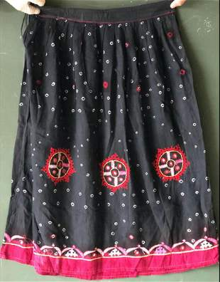AN INDIAN BLACK SILK SKIRT AND SHAWL SET, each with