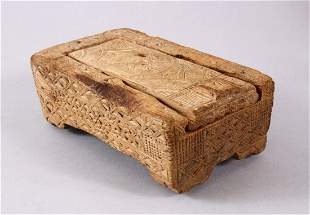 A GOOD EARLY NORTH AFRICAN CARVED WOODEN MAKEUP BOX,