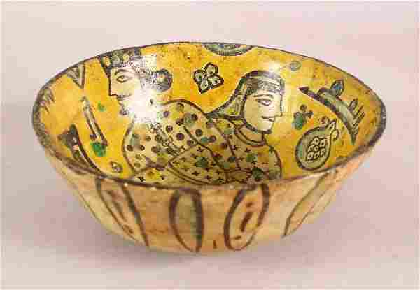 AN IRANIAN BUFF WARE GLAZED POTTERY BOWL, the inner