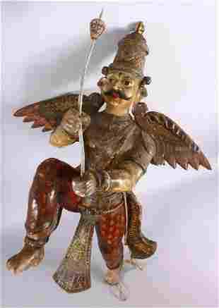 A 19TH CENTURY INDIAN / BURMESE CARVED WOOD FIGURE OF A
