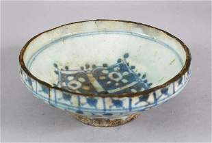 AN EARLY PERSIAN TIMURID BLUE AND WHITE GLAZED POTTERY